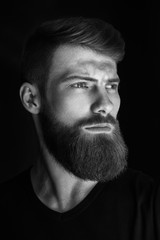 Vertical portrait of a man with beard and modern hairstyle