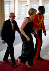 Britain's Prime Minister May and her husband Philip arrive for The Queen's Dinner during the Commonwealth Heads of Government Meeting at Buckingham Palace in London, Britain