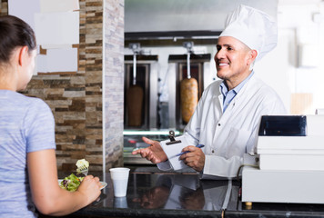 man chef  giving order with kebab