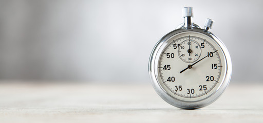 Analog stopwatch on grey background