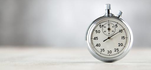 Analog stopwatch on grey background