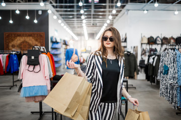 Woman with shopping bags enjoying in shopping. Lifestyle
