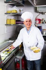 man chef serving fresh kebab
