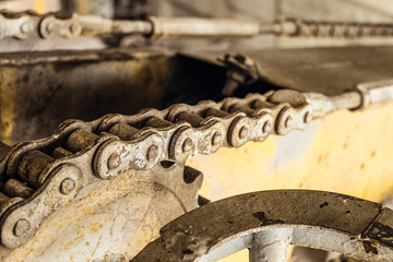 Steel gear wheel with chain drive of a boom mobile platform truck. Chain transmission. Limited depth of field.