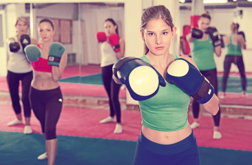 Portrait of  female is boxing exercises