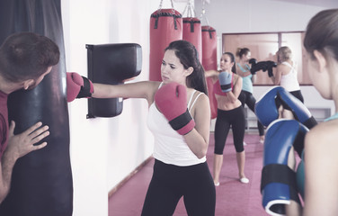 Woman training with punching bag
