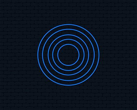 Neon light. Target aim sign icon. Darts board symbol. Glowing graphic design. Brick wall. Vector