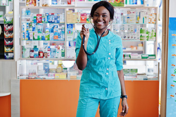 African american pharmacist working in drugstore at hospital pharmacy. African healthcare. Stethoscope on black woman doctor.