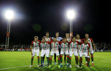 Agropecuario soccer players pose for a team photo before their Argentine Second Division match against Almagro at Ofelia Rosenzuaig stadium in Carlos Casares