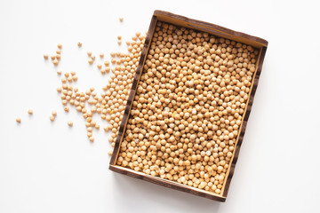 dry raw chickpeas in wooden box