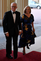 Australia's Prime Minister Turnbull and his wife Lucy arrive for The Queen's Dinner during the Commonwealth Heads of Government Meeting at Buckingham Palace in London, Britain