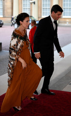 New Zealand's Prime Minister Ardern and her partner Gayford arrive for The Queen's Dinner during the Commonwealth Heads of Government Meeting at Buckingham Palace in London, Britain