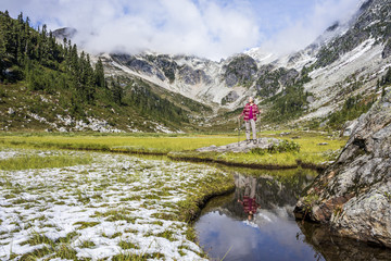 Woman hiking through Brandywine Meadows, Whistler, British Columbia, Canada