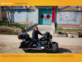 The Wider Image: Trade tensions with U.S. testing Chinese consumers