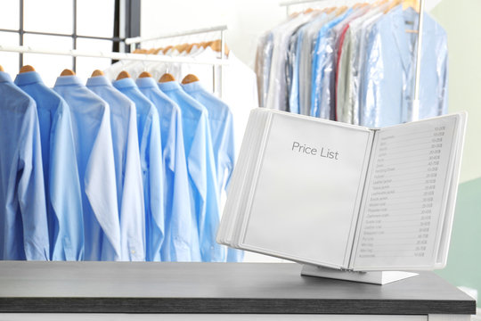 Workplace of receptionist with price list at dry-cleaner's
