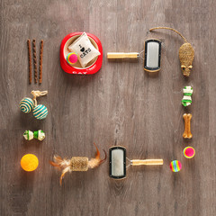 Flat lay composition with cat accessories on wooden background