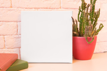 Mockup poster. White empty canvas in modern pink interior.