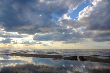 Cloud reflection in water on a beach