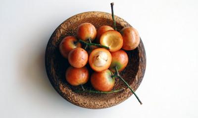 Menteng fruit or Baccaurea racemosa on wood plate.