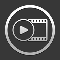 movie strip with play symbol in circle. simple silhouette. icon in circle on dark background with simple shadow