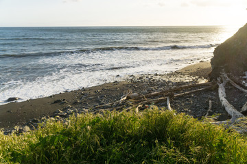Grassy overlook on a cliff at sunset on the Lost Coast backpacking trail in California