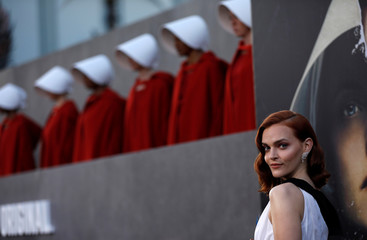 "Cast member Brewer poses at the premiere for the second season of the television series ""The Handmaid's Tale"" in Los Angeles"