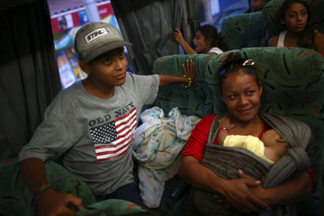 Central American migrants, moving in a caravan through Mexico, travel to Mazatlan, as part of their new travel route, in Tlaquepaqu
