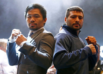"Pacquiao and Matthysse attend a news conference for their upcoming WBA ""regular"" welterweight title fight, in Kuala Lumpur"