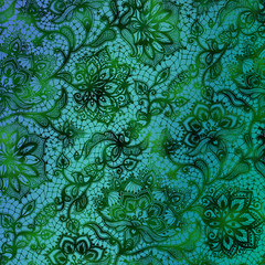 Green and blue gradient paper with a black floral lace design.