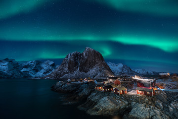 Fisherman village with Aurora in the background / travel concept world explore northern light