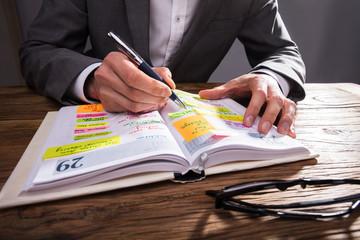 Fototapete - Businessperson Writing Schedule In Diary