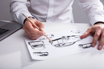 Artist Sketching On Paper With Pencil