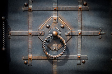 door decoration with ornate wrought-iron elements, close up