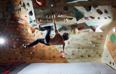 man climber climbs indoors