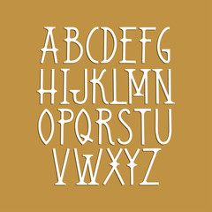 Vector capital font in Art Deco style on a gold background.