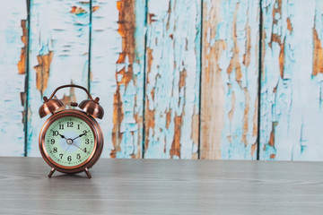 Vintage alarm clock on wood background