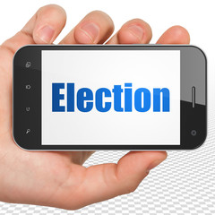 Politics concept: Hand Holding Smartphone with blue text Election on display, 3D rendering