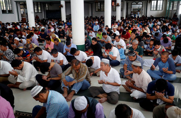 Residents pray in a mosque located near the main battle area, in Islamic city of Marawi, southern Philippines
