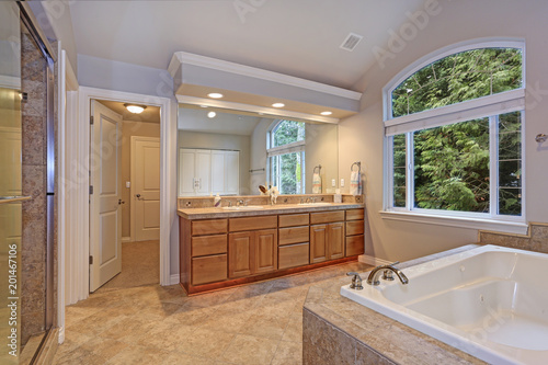 narrow home laundry with white cabinets and red appliances stock rh fotolia com Laundry Countertop with Cabinet Laundry Countertop with Cabinet
