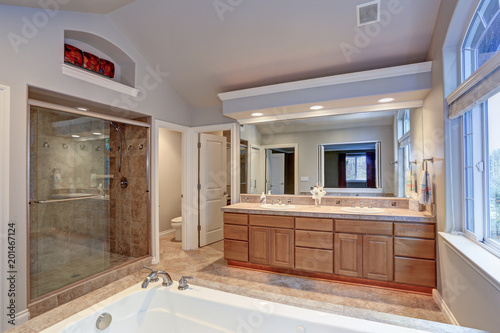 narrow home laundry with white cabinets and red appliances stock rh fotolia com White Laundry Room Cabinets White Laundry Room Cabinets