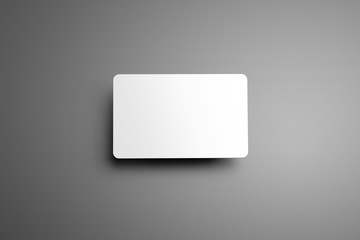 Universal blank mockup  one bank (gift) card with shadows on a gray background. Wall mural