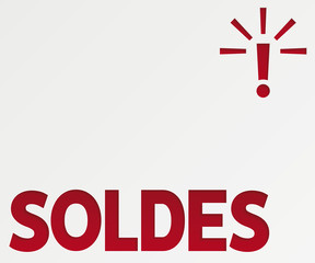 Sale in French. Poster to announce the sales with the word soldes cut out on paper.
