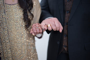 pakistani Indian brides groom hands showing rings and jewelry photoshoot