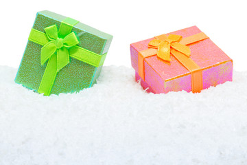 Two square gift boxes in snow