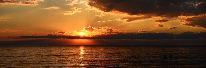 Fototapete - panorama of beutiful orange sunset on the calm sea