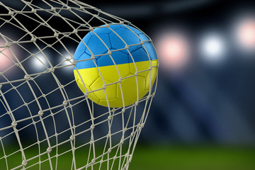 Ukrainian soccerball in net