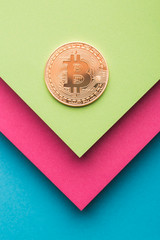 Overhead view of bitcoin on colorful background
