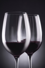close-up shot of glasses of delicious red wine on black