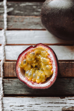 Passion fruit and coconut on table