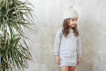Children's fashion. Stylish baby girl in grey dress